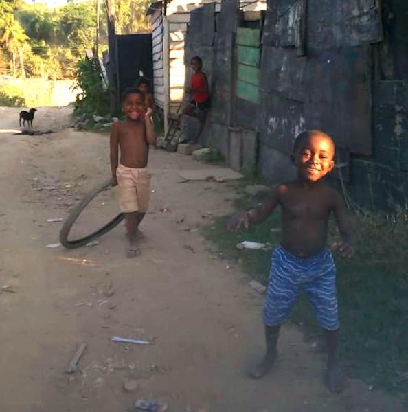 2 boys running in the street
